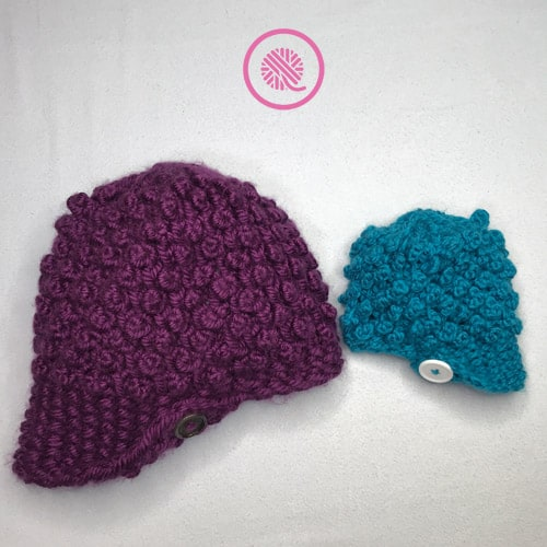 Bobble Button Newsboy Hat shown in woman's and baby's sizes