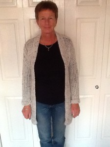 Longer length body & sleeves with cuff.  Using 1 strand of Aran. Collared Cardigan