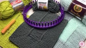 Ten Stitch Samples with different yarn and Purple Knifty Knitter Loom