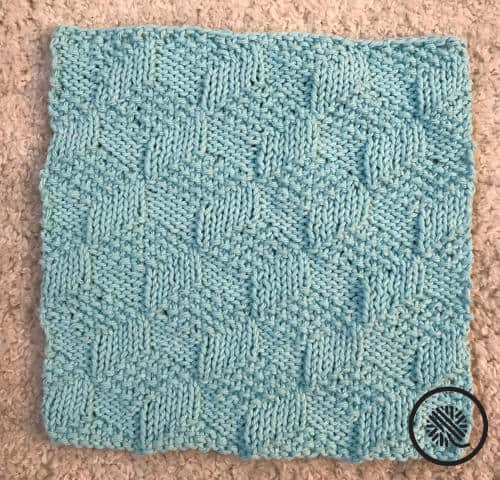 knit tumbling moss blocks washcloth pattern finished project in blue