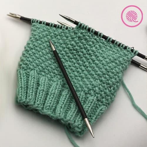 needle knit edelweiss hat in progress on DPNs