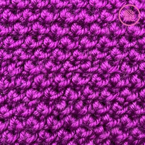 needle knit reverse edelweiss stitch pattern close up