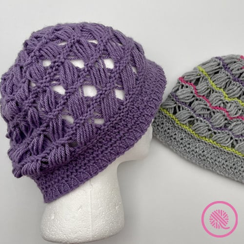 Breezy Retreat hat shown in solid purple or gray with contrast stripes