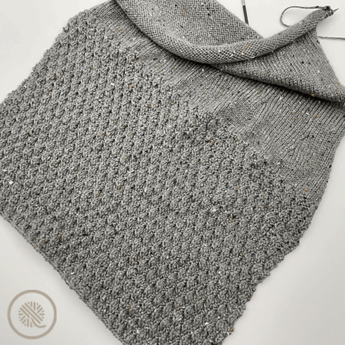 needle knit cozy ripple twist pillow progress pic